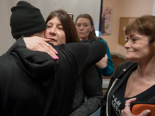 Lisa Vandegrift of Browns Mills, center facing, hugs Brian Lanbeth of Pemberton following a Narcan training class held at St. Mark Lutheran Church in Pemberton.  Vandegrift is organizing Narcan training classes in response to the opioid epidemic in Burlington County. So far this year, there have been 30 suspected overdose deaths in the county.