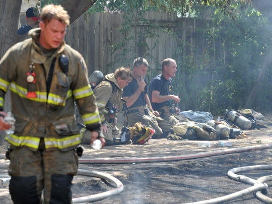 Wichita Falls firefighters sought shade in an attempt