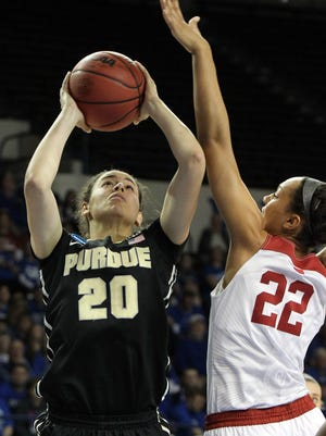 Purdue's Dominique McBryde (20) shoots while pressured by Oklahoma's Shaya Kellogg (22) during a first round women's college basketball game in the NCAA Tournament in Lexington, Ky., Saturday, March 19, 2016. Oklahoma won 61-45. (AP Photo/James Crisp)