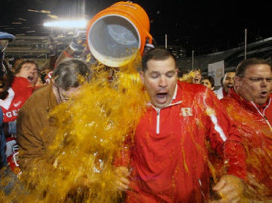 Then-Rutgers football coach Greg Schiano (right) and then-athletic director Bob Mulcahy get a Gatorade shower after Rutgers beat North Carolina State in the 2008 PapaJohns.com Bowl. (File photo)