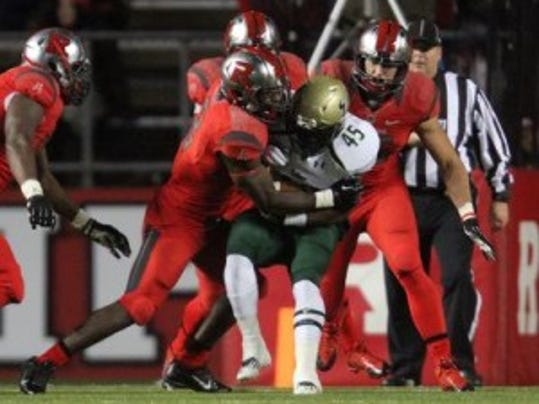 Steve Longa brings down a South Florida ball-carrier for one of his 123 tackles last season, which was the highest total among all freshmen in the nation. (MyCentralJersey.com file photo)