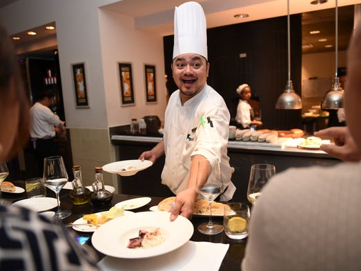 Chef Brendan Makahi serves and entertains his guests