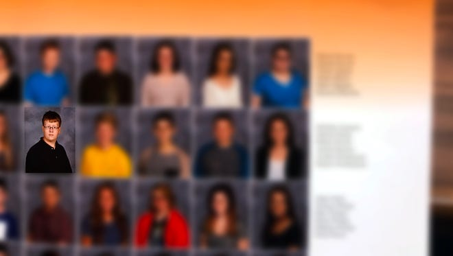 Marshall County High School yearbook photo of Gabe Parker. Other faces have been obscured to protect the students' identities.