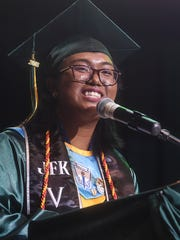 Class salutatorian Seanna Talavera Bataclan delivers a speech during the John F. Kennedy High School Class of 2018 Commencement Ceremony at the University of Guam Calvo Field House on June 9, 2018.