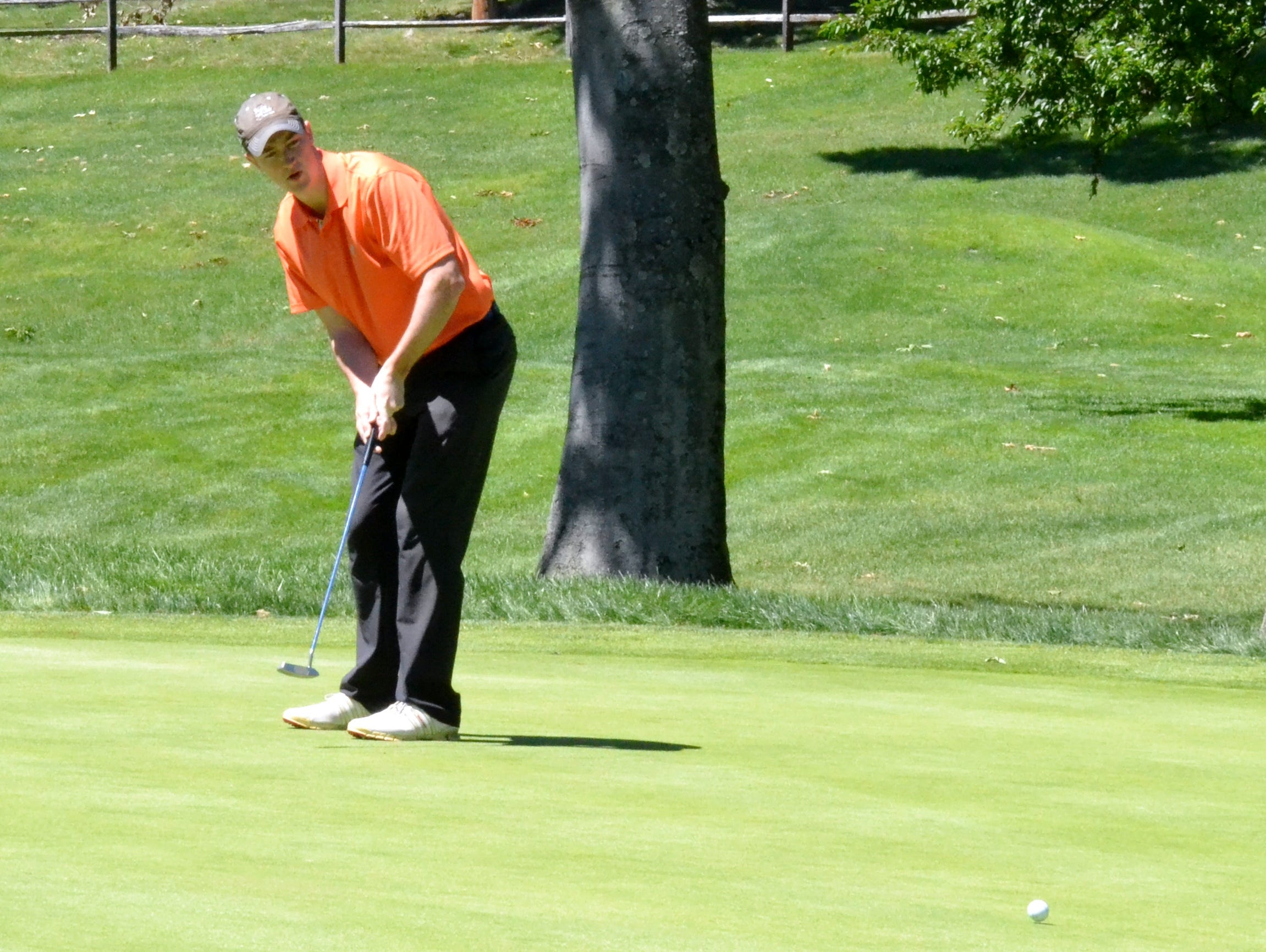 Defending champion Luke Feehan watches a birdie putt slide past the hole Tuesday during the Round of 32 at the Westchester Amateur.