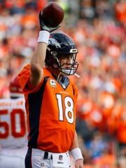 Denver Broncos quarterback Peyton Manning (18) acknowledges the crowd after setting the new passing record against the Kansas City Chiefs on Sunday.