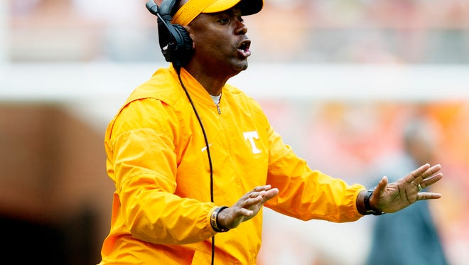 Vols special teams coordinator and defensive backs coach Charlton Warren calls during the Orange & White Game at Neyland Stadium on April 22, 2017.
