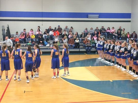 Forbes Road's girls basketball team stands next to