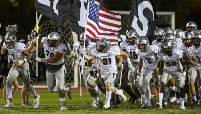 Chandler Hamilton takes the field to play Phoenix Brophy Prep at Phoenix Community College on September 30, 2016 in Phoenix.