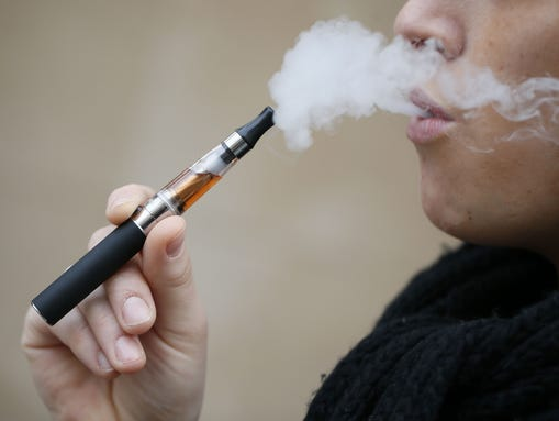 A person smokes an electronic cigarette on March 05,