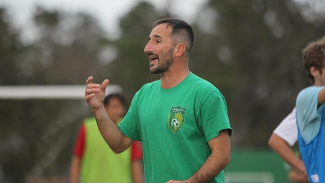 First-year Lincoln boys soccer coach Josh Bruno talks to his team during practice this week.