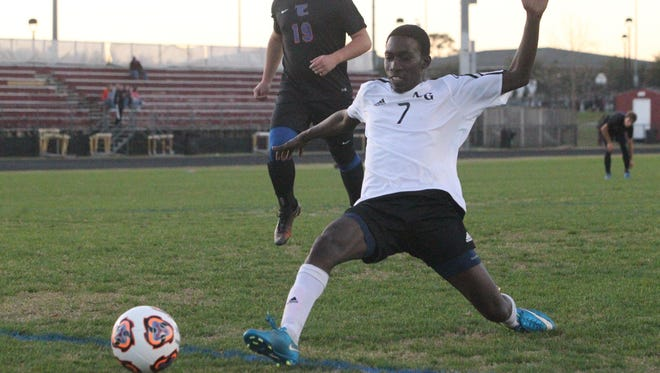 Godby senior Serigne Ndiaye toe touches a goal in the first half of the Cougars' 3-0 win over Taylor County in Tuesday night's District 2-2A quarterfinal at Florida High.