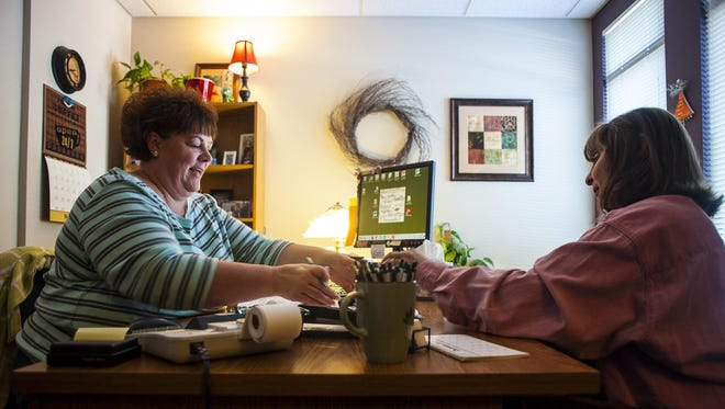 """Paula Reed, financial counselor and coach, and Rural Dynamics Inc. have been helping Jeannine Smith with her financial situation for about two years. """"You can see the light at the end of the tunnel,"""" Smith said. """"There is hope knowing it can get better."""""""