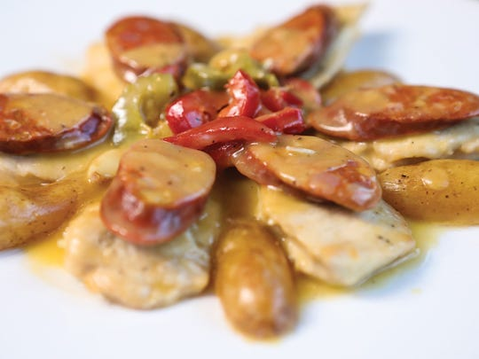 Sauteed Chicken Breast with chorizo and cherry peppers at La Taberna in Dumont.