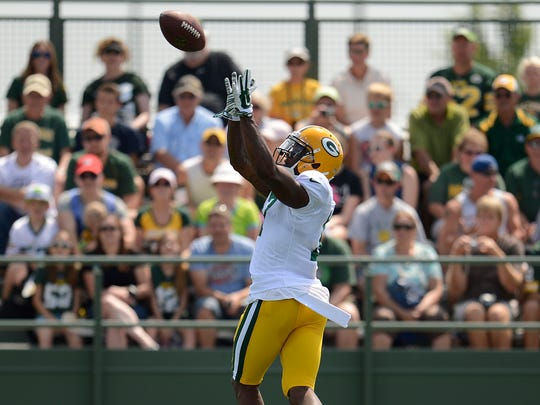 Packers receiver Davante Adams (17) makes a catch during training camp practice at Ray Nitschke Field.