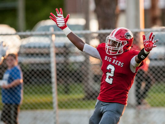 Port Huron senior JaVonte Nichols celebrates scoring a touchdown during a football game Friday, August 26, 2016 at Port Huron High School's Memorial Stadium.