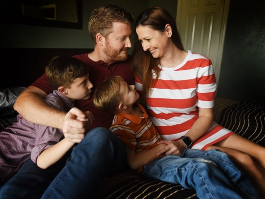 Noah, Zack, Micah and Lisa Wilson are together at home