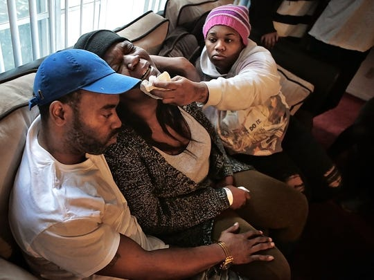 Latoya Tatum (center) comforted by Deon Allen (left) and Tairanika Collins as she grieves for her daughter Kiara Tatum, 18, who was killed on New Years Day in Southeast Memphis. Tatum is the first Memphis murder victim in 2017.