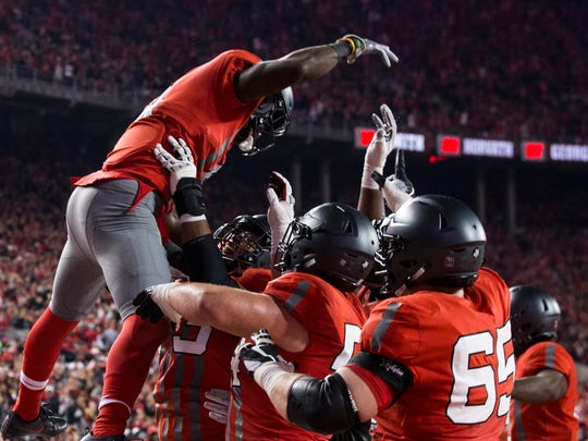 Ohio State offensive guard Michael Jordan tosses Curtis Samuel in the air after he catches a one-yard jump pass from J.T. Barrett for a touchdown just before halftime in Saturday's 62-3 rout of Nebraska.
