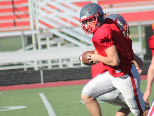 Kyle Proffitt sprints out from behind center at Goshen football practice. Proffitt threw for 258 yards and four touchdowns against Clinton-Massie Oct. 13.
