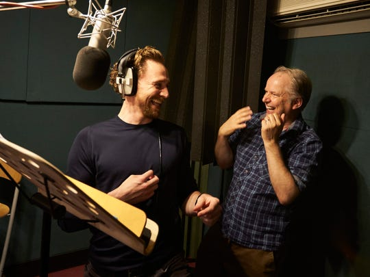 Tom Hiddleston (left) and  Nick Park work in the studio