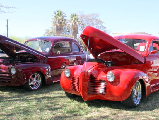 Two coupes dueled in the sun Saturday. The maroon '46