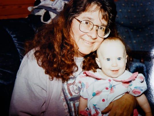 Marilyn Blewer holds one of her grandchildren.