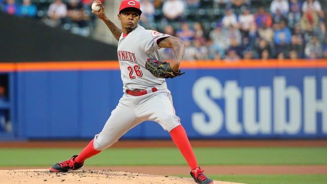 Cincinnati Reds starting pitcher Raisel Iglesias (26) pitches during the first inning against the New York Mets at Citi Field.