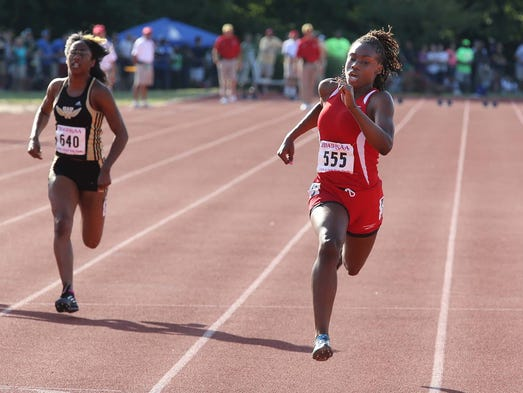 Lynna Irby, Pike freshman wins the 100 meters. The girls IHSAA state track meet was held on the Indiana University campus Friday June 6, 2014.