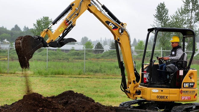 Albany Options School student Eugenio Garcia learns how to use an excavator during the 12th annual Construction Career Day at the Salem Airport, on Tuesday in Salem.
