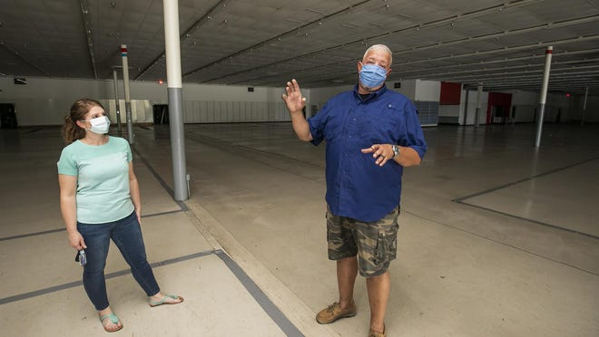 Troy Waranka and his wife, Tina, talk about the plans for the Boulevard Flea Market, an indoor flea market planned for the 112,000-square-foot former Kmart store near the intersection of Silver Springs Boulevard and Northeast 36th Avenue.