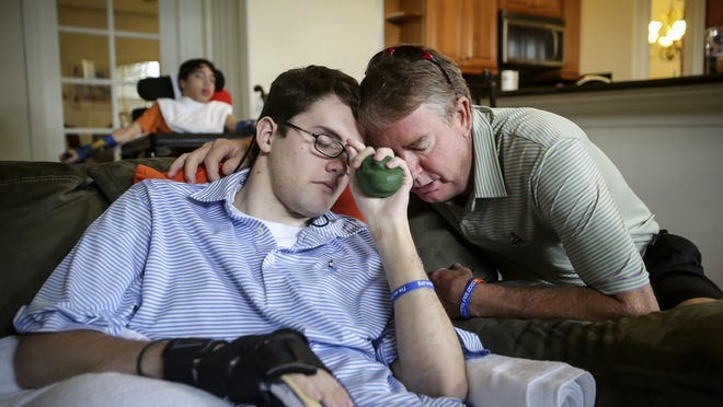 Craig Dolch visits his son Eric at his group home in Loxahatchee in  2013.