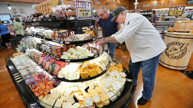 Cheese Supervisor Mark Dank straightens the cheese products at the new Fresh Thyme Farmers Market on Thursday, June 12, 2014. The opening of the new Fresh Thyme Farmers Market in Greenwood brought a massive amount of residents to check out the new store that offers many alternatives from other markets. This is the second store opened by the company and the first ever in Indiana bringing more than 100 jobs to the community. More stores are set to open in Indianapolis in the Fall of 2014.