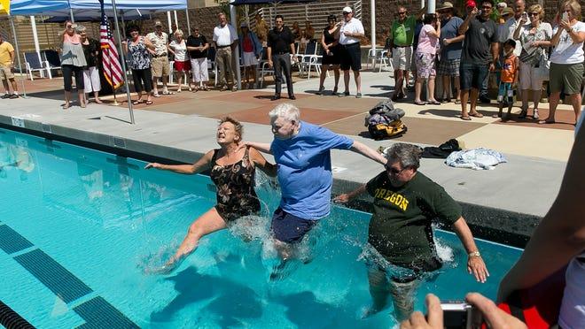 John Furbee, center, joins in the inaugural swim at the opening of the John Furbee Aquatics Center in June 2013 in Desert Hot Springs.