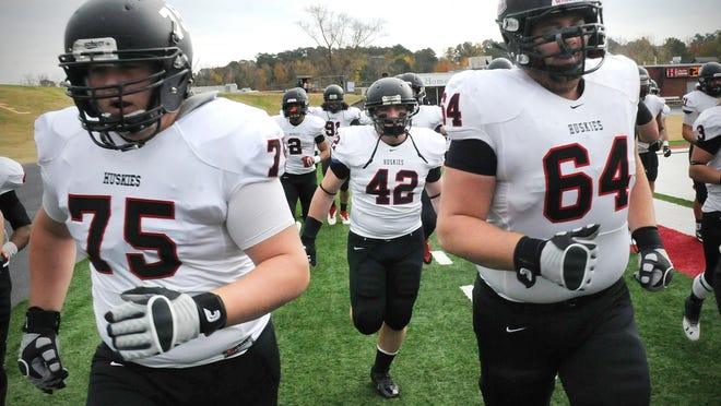 St. Cloud State linebacker Adam Josephson (42) runs on to the field prior to the Huskies' Division II playoff game at Henderson State (Ark.) last November in Arkadelphia, Ark.