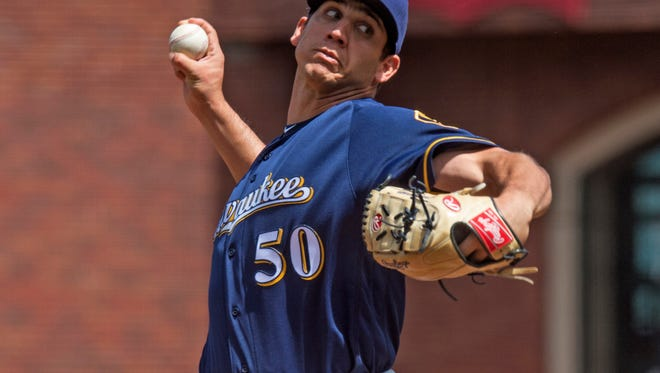 Jun 15, 2016; San Francisco, CA, USA; Milwaukee Brewers relief pitcher Jacob Barnes (50) throws a pitch during the seventh inning against the San Francisco Giants at AT&T Park. Mandatory Credit: Kenny Karst-USA TODAY Sports
