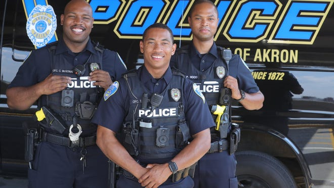 Akron police officers Cameron McGowan, left, Truvonte Riley, and Paul Hood on Thursday, July 9, 2020, Akron, Ohio.