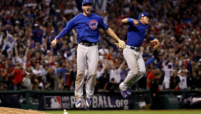 Kris Bryant (left) and Addison Russell of the Chicago Cubs celebrate after defeating the Cleveland Indians in Game Seven of the 2016 World Series. The Cubs won their first World Series in 108 years.