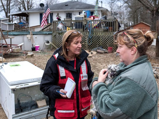 During a home visit, American Red Cross worker Mary Broad asks Debbie Melton about what type of assistance her family may need during the flood recovery process Wednesday afternoon, March 7, 2018. The American Red Cross gave the Meltons a debit card loaded with money to use for short term needs like gas, food and shelter and several Goodwill vouchers for clothing.