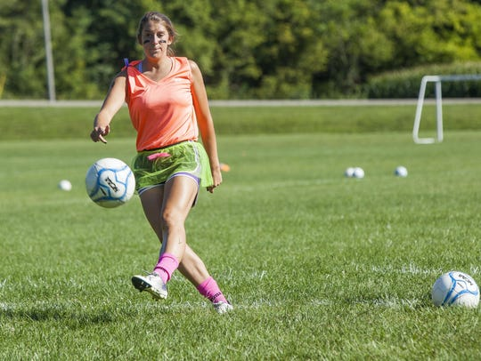 Olivia Malott works with her team Friday afternoon