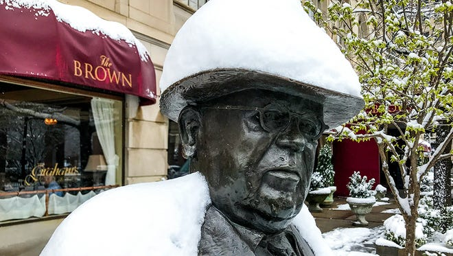 Snow accumulated on the statue of J. Graham Brown in front of the Brown Hotel in downtown Louisville.
