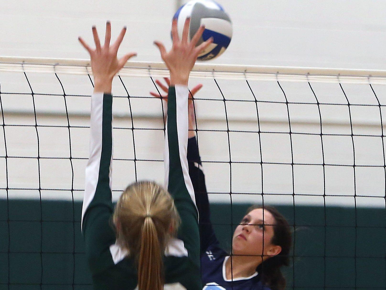 Westlake's Nicolette Shkreli (2) gets a shot by Pleasantville's Annie Stockel (10) during volleyball action at Pleasantville High School Sept. 30, 2015.