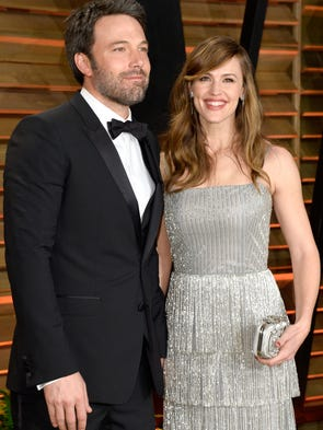 Actors Ben Affleck (L) and Jennifer Garner attend the
