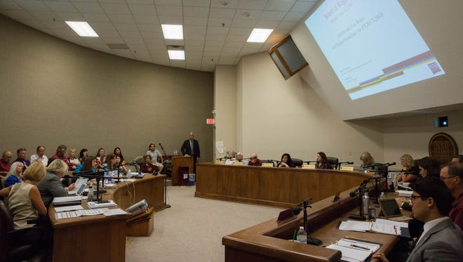 The New Mexico State University Board of Regents listens to a presentation in June 2017.