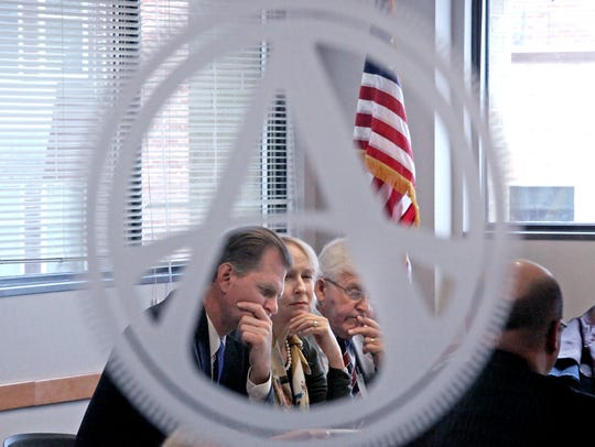 In this Dec. 17, 2013 file photo, members of the Wisconsin