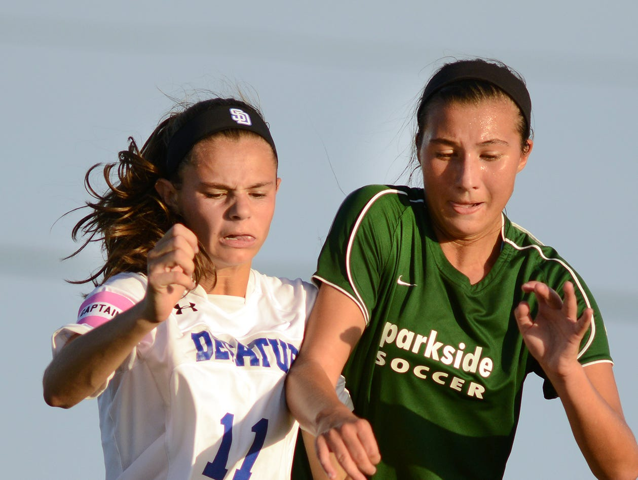 Stephen Decatur's Ally Beck fights for posession of the ball with Parkside's Julie Venere during play Tuesday afternoon at Decatur.