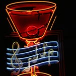 """The Red Key's iconic neon sign, in better times. The musical notes play: """"How Dry I Am,"""" and that's a Manhattan, not a Martini."""