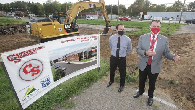 Canton Local Superintendent Steve Milano, right, speaks about the Canton South Middle School project Monday during at the groundbreaking ceremony along with project manager Chris Bader of the GPD Group.