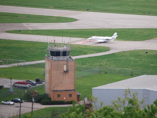 A plane taxis along the runway at Lunken Airport.