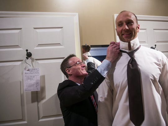 David Dubs, left, owner of Hanover Clothing Company, helps Bryan Cuffley of Hanover with a tuxedo rental fitting on Oct. 22, 2014 at the downtown Hanover Clothing Company.  Cuffley was preparing for his sister's wedding on the weekend.